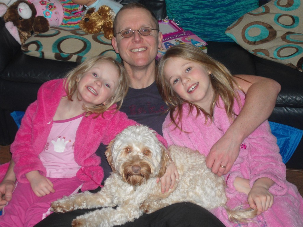 Ian Purvis with daughters Lauren and Eve and missing dog Izzy